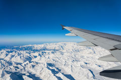 Plane snow mountain Royalty Free Stock Image
