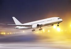 Plane in snowstorm. Airport and white plane taking off at non-flying weather, snowstorm Stock Photo