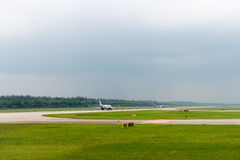 Plane speed up on airport runway Royalty Free Stock Images