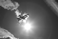 Plane into the sun Stock Image