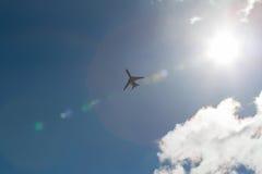 Plane and sun Stock Photos
