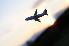 Plane at sunset Royalty Free Stock Photo