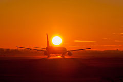 Plane in sunset Royalty Free Stock Images