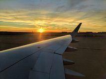 Plane Sunset. Sunsetting through a plane window in Dallas Texas Stock Image