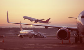 Plane on takeoff. Airport, the plane on takeoff, landscape royalty free stock photo