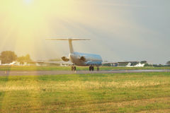 Plane takeoff on sunset Royalty Free Stock Photos