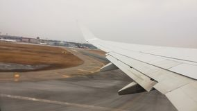 Plane takes off. View from the porthole on the wing of the plane on the runway stock video footage