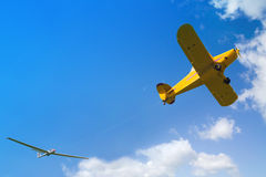 Plane taking glider in the sky Royalty Free Stock Image