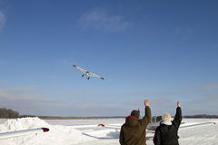 Plane taking off from frozen lake Stock Images