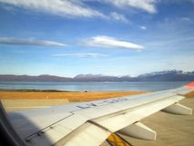 Plane taking off from Malvinas Argentinas International Airport Ushuaia stock photos