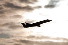 Plane taking off silhouette Stock Images