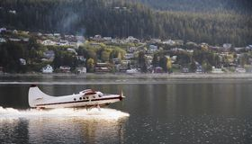 Plane Taking off in Skagway royalty free stock photography