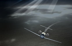 Plane taking off in the sky over the sea Stock Photos