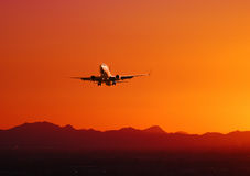 Plane taking off at sunset, Arizona Stock Images