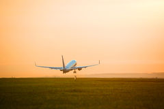 Plane taking off sunset. Jet airplane is taking off Royalty Free Stock Photo