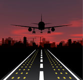 The plane is taking off at sunset and night city Royalty Free Stock Image