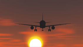 The plane is taking off at sunset Stock Images