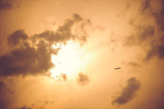 A plane taking off on the won sunset sky Royalty Free Stock Photography