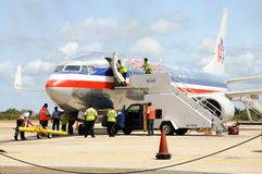 Plane on tarmac. An American Airways passenger jet undergoes a security check on the ground at Belize International airport Stock Photography