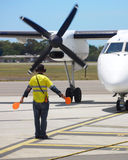 Plane taxiing. A plane being guided on tarmac Royalty Free Stock Images