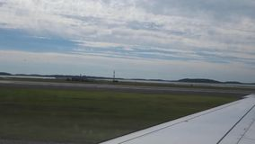 Plane Taxiing. An airplane taxiing at Logan International Airport stock footage