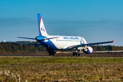 KHABAROVSK, RUSSIA - SEP 29, 2018: Airbus A320 VP-BBQ Ural Airlines taxiing for take off at Khabarovsk international royalty free stock photography