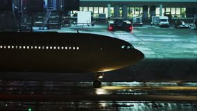 Plane at terminal gate, night view, Munich. Lufthansa jet in Munich Airport, night view. Plane doing taxi in the night stock video footage