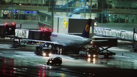 Plane at terminal gate, night view, Munich. South African jet in Munich Airport, night view. Plane doing taxi in the night stock footage