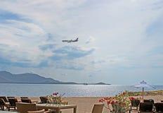 Plane of Thai Airways flies over Samui resort stock images