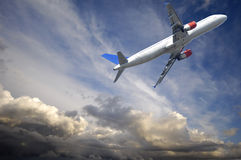 Plane and thunder clouds stock images