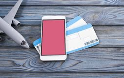 Plane tickets, smartphone. On a wooden background. romantic trip Royalty Free Stock Photos