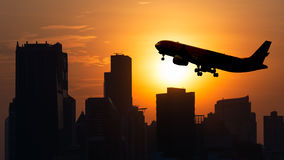 Plane Towers Sunset. Towers at city under sunset Royalty Free Stock Images