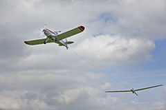 Plane towing glider Stock Photos