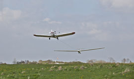 Plane towing glider Stock Photo