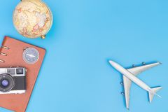 Plane toy and travel objects on blue for travel concept Stock Photography