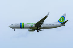 Plane from Transavia PH-HSF Boeing 737-800 is landing at Schiphol Airport. Stock Photo