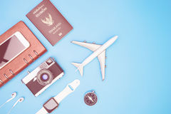 Plane and travel objects on blue background Stock Images