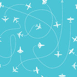 Plane travel seamless pattern. World travelling blue endless vector background with dashed path lines Stock Images