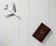 Plane travel on white wooden table with Passport. Royalty Free Stock Image