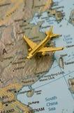 Plane Traveling Through China Stock Photography