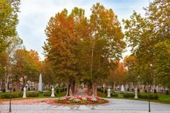 Plane trees avenue and the music pavilion in Zrinjevac park in Zagreb, Croatia, in autumn. View of the plane trees avenue and the music pavilion, water fountains stock images