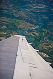 Plane turning over french country side and river Royalty Free Stock Photo