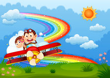 A plane with two boastful monkeys and a rainbow in the sky Royalty Free Stock Photos