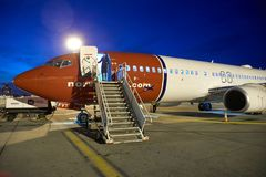 Plane unboarding with stairs at night stock photography