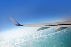 Plane view. View from plane over the wing to clouds and ocean underneath Royalty Free Stock Photos