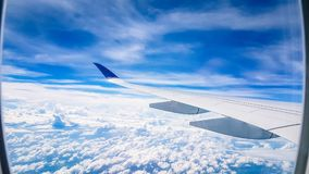 Plane view from window on flight. Travelling around South East asia with views of clouds and airports stock photo