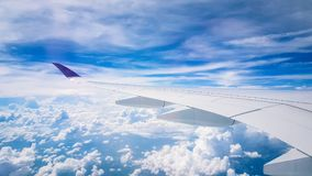 Plane view from window on flight. Travelling around South East asia with views of clouds and airports stock photos