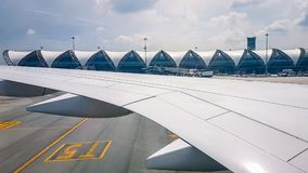 Plane view from window on flight. Travelling around South East asia with views of clouds and airports royalty free stock photography