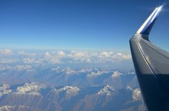 Plane view from the window on mountains and the blue sky. Plane view from the window on mountains and blue sky royalty free stock images