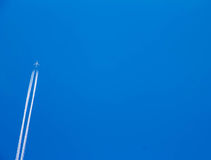 The plane was in the blue sky.(2) Stock Image